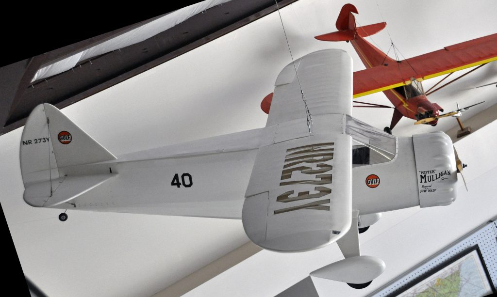 """The DGA-6 (first flown in 1934) was the only racer of the thirties that had the distinction to be developed into a successful production aircraft for both the civil and military market (Howard DGA-8 through DGA-12). NR273Y, the only DGA-6 built, was powered by an 850 hp Pratt & Whitney R-1340 Wasp S.E. nine-cylinder air-cooled radial engine (DGA stood for """"Damn Good Airplane""""). In the 1936 Bendix race the aircraft lost a propeller blade and crash-landed in New Mexico, USA, Howard and his wife were injured, the aircraft was damaged beyond repair."""